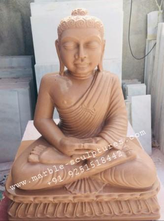 red sandstone buddha statue
