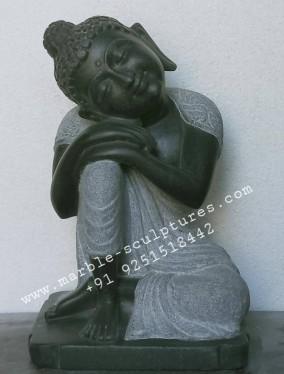 sitting black buddha statue