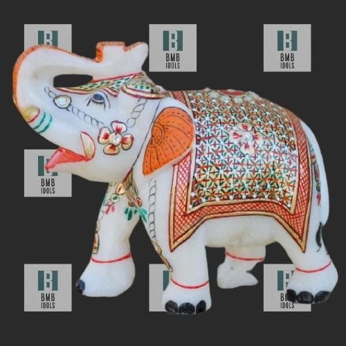 painted marble elephant figure