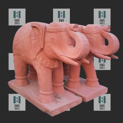 red elephant statues